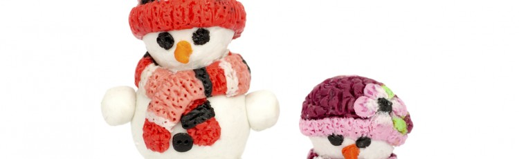 Hand made plasticine or modeling clay figure of snowman on white background.Christmas decoration